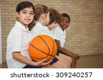 students sitting on a sports... | Shutterstock . vector #309240257