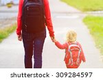 mother holding hand of little... | Shutterstock . vector #309284597