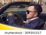 stylish man sitting in sport car | Shutterstock . vector #309301517