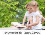 little boy and girl with book... | Shutterstock . vector #309323903