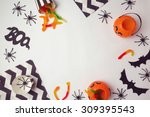 Small photo of Halloween holiday background with spiders and candy. View from above