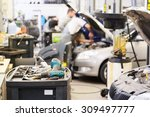 interior of a car repair shop | Shutterstock . vector #309497777