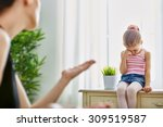 Small photo of mother scolds her child