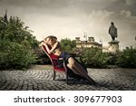 beautiful blonde woman sitting... | Shutterstock . vector #309677903
