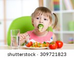 child little girl eats... | Shutterstock . vector #309721823