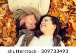 Small photo of love, relationship, season, family and people concept - close up of smiling couple lying in autumn park