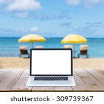 laptop computer on wood table... | Shutterstock . vector #309739367