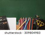 School Supplies On Green Board...