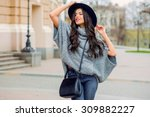 outdoor fashion portrait of... | Shutterstock . vector #309882227
