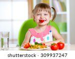 funny kid girl eating healthy... | Shutterstock . vector #309937247