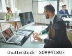 young employee looking at... | Shutterstock . vector #309941807