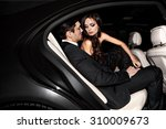 sexy couple in the car.... | Shutterstock . vector #310009673
