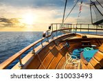 Wooden Sailboat In The Sea At...