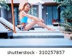 asia beautiful woman using a...   Shutterstock . vector #310257857