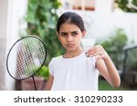 Young Girl Playing Badminton...