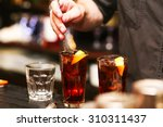 barman stir alcohol. process of ... | Shutterstock . vector #310311437