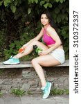 fitness girl  with earphones ... | Shutterstock . vector #310372337