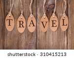 travel incription on brown tags ... | Shutterstock . vector #310415213