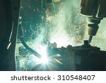 welding robots movement in a... | Shutterstock . vector #310548407
