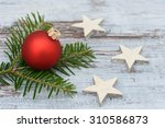 red xmas bauble and pine branch ... | Shutterstock . vector #310586873