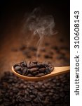 close up coffee beans on wooden ... | Shutterstock . vector #310608143