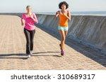 two sporty women jogging... | Shutterstock . vector #310689317