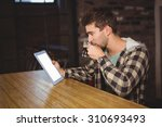 hipster drinking coffee and... | Shutterstock . vector #310693493