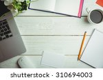 overhead view of an desk with...   Shutterstock . vector #310694003