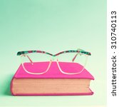 Small photo of Hipster glasses and book