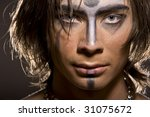 Portrait of young male model wearing artistic bodypaint drawing - stock photo