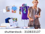 young fashion designer working... | Shutterstock . vector #310833137
