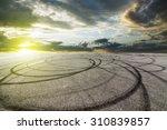 sunset asphalt asphalt tire... | Shutterstock . vector #310839857