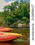 kayaking on a river. summer... | Shutterstock . vector #310898627