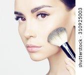 studio fashion photo of... | Shutterstock . vector #310925003