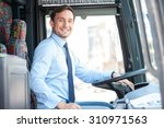 handsome bus driver is sitting... | Shutterstock . vector #310971563