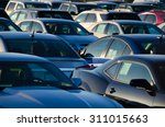 sunrise at a jam packed parking ... | Shutterstock . vector #311015663