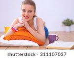 Smiling Young Woman Lying On A...