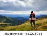 man traveler hiking in the... | Shutterstock . vector #311215763