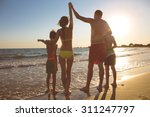 young family on the beach | Shutterstock . vector #311247797