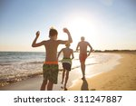 young family on the beach | Shutterstock . vector #311247887