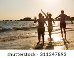 young family on the beach | Shutterstock . vector #311247893