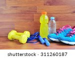 sport equipment on wooden floor. | Shutterstock . vector #311260187