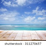 wood table with blur  seascape... | Shutterstock . vector #311270657