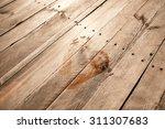 Wet Human Footprints On Dark...