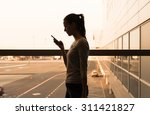 young female using her phone... | Shutterstock . vector #311421827