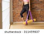 unrecognizable woman in a yoga... | Shutterstock . vector #311459837