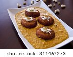 cottage cheese balls in white... | Shutterstock . vector #311462273