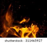 fire flames with sparks on a... | Shutterstock . vector #311465927