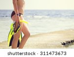 young woman holding snorkeling... | Shutterstock . vector #311473673