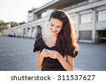young business woman talking on ... | Shutterstock . vector #311537627